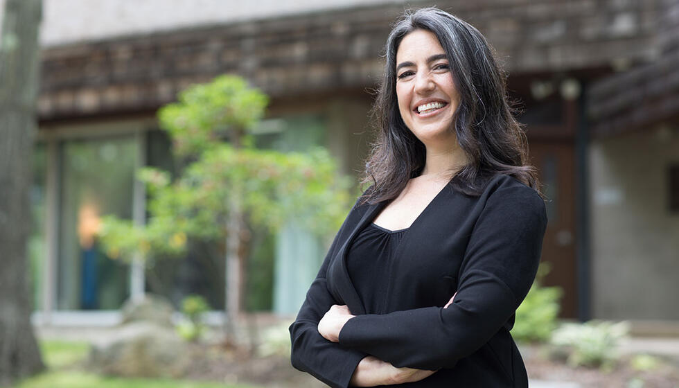 Lauren standing in front of the Usdan Administrative building.