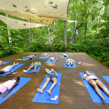 Students lying on yoga platform