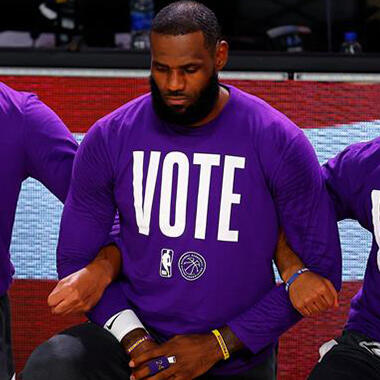 Los Angeles Lakers players Davis, James, and Cook kneel during the national anthem befo