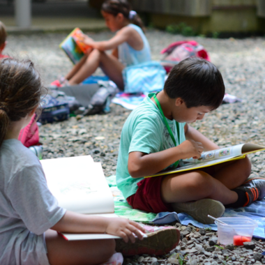 students study on the gravel outside